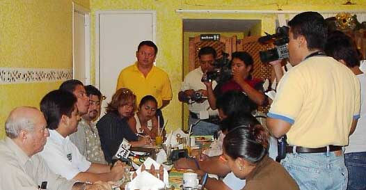 Dr. Victor Zavala (seated third from left) shares observations from the assessment conducted in January 2004 with Presidente Carlos Hernandez Blanco (seated second from left) and the press.