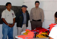 From left: Daniel Alvarez Villanueva, Director Civil Protection; Jorge Martin Angulo, General Secretary; and Gustavo Maldonado Saldana, 8th Precinct Councilman, receive rescue equipment on behalf of the Water Rescue Committee of Cozumel. Maldonado expressed,